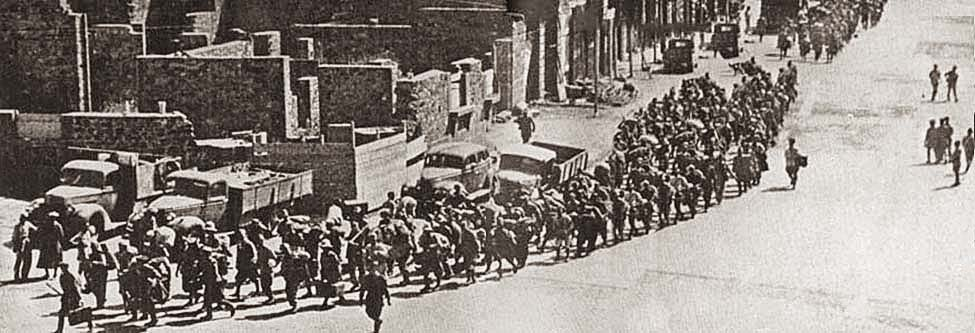 Italian prisoners marching through Gondar under escort