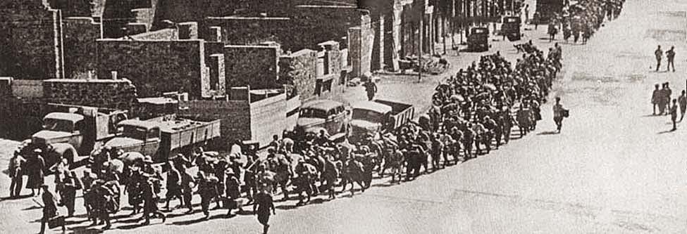 Italian prisoners marching through Gondar under escort