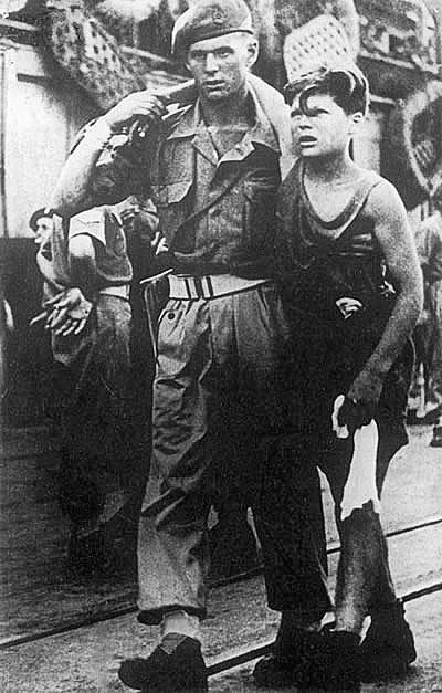 British soldier leads refugee from Exodus 1947
