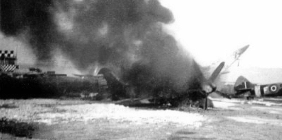 RAF Spitfire in flames after attack by Egyptian air force on Ramit David airfileld, Israel 22 May 1948